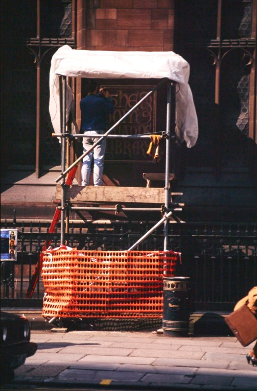 A carver working on a platform