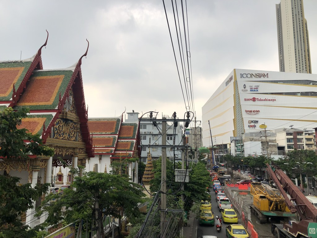 Picture of Bangkok — road through the middle, temple on the left, ICONSIAM on the right