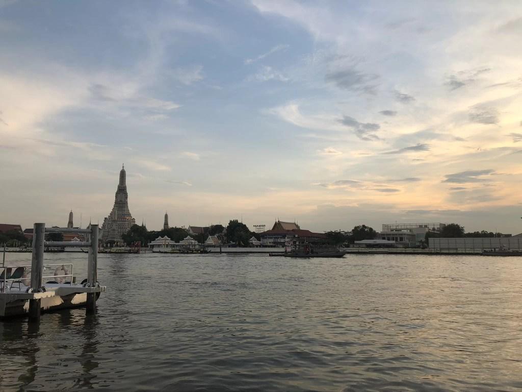 Wat Arun, seen across the Chao Phraya River as the sun sets