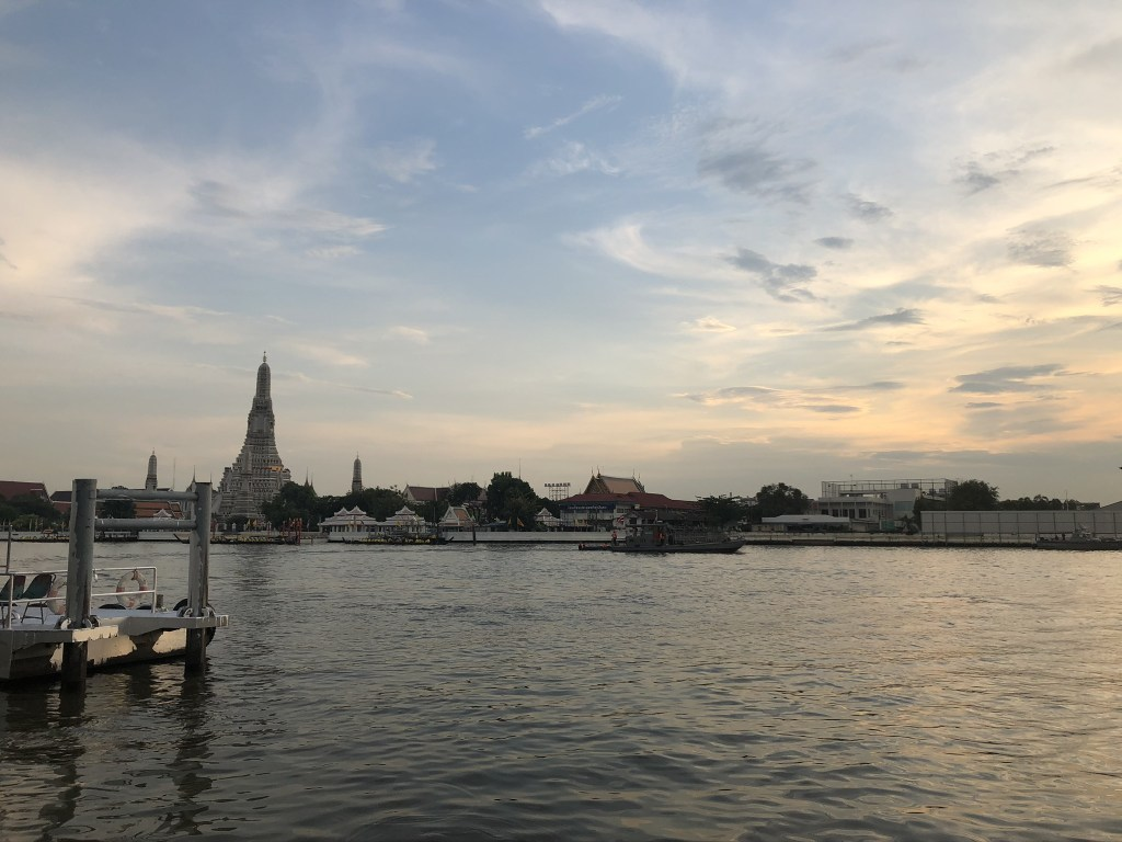 Wat Arun, seen across the Chao Phraya River as the sun sets