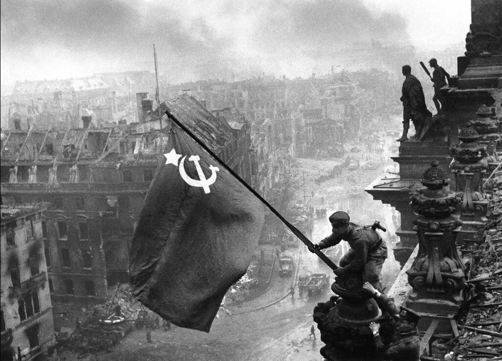 Famous picture of Soviets raising the union flag over the Reichstag. Vasily Grossman saw this sight following the events of Life and Fate.