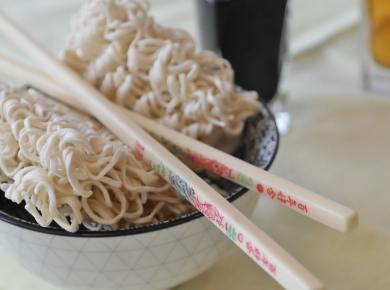 bowl of ramen noodles with chopsticks