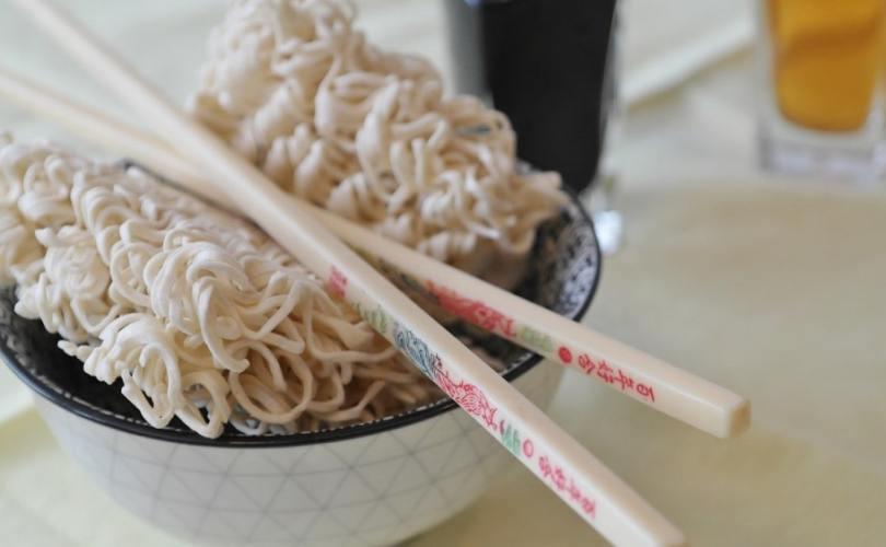 bowl of ramen noodles with chopsticks