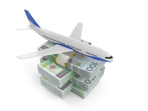 Airplane on stack of money isolated on white background. 3d illustration