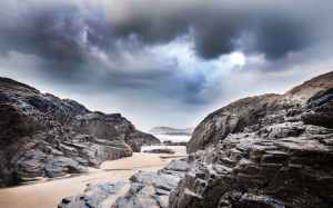 gray rock formation under clouds at daytime
