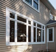 harvest wheat board and batten siding with almond trim on benjamin moore house paint simulator id=16519