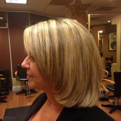 long layers heavy honey blonde highlights and a great contrast with the darker brown underneath