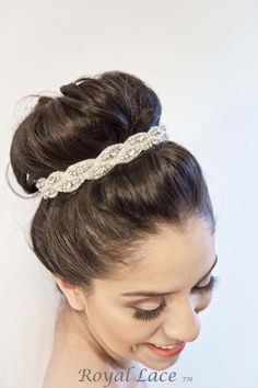 High Bun with Heavy Accessories - 8 Bridal Hairstyles worth trying - Get This Look