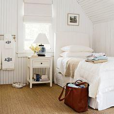 A clean, white bedro