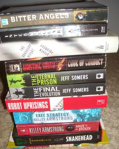 A stack of books that need new homes.