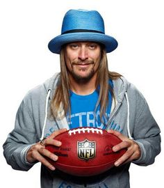 Kid Rock holding a football