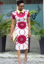 Chimamanda Ngozi Adichie cute outfits - Pink, Purple and White Sheath dress, and yellow blouse