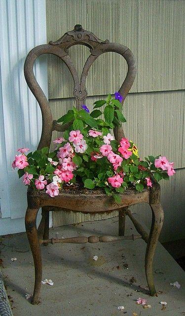 I love this idea! Chair planter.