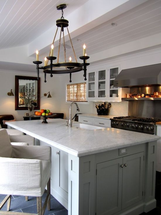 love the chandler above the island and the glass cabinets – if that's a shel