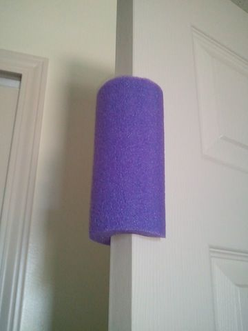 Inexpensive Toddler Proof Door Stopper – use a pool noodle! No more shutting doo
