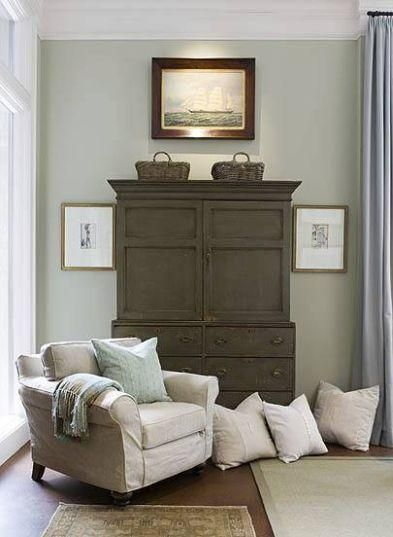 max & co. gray sitting area. oatmeal slip-covered accent chair and pillows, pain