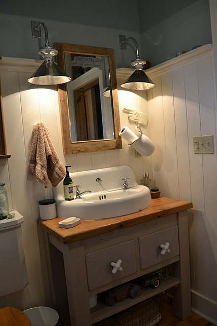 I love this farmhouse bathroom. The pitcher paper towel holder is a great idea,