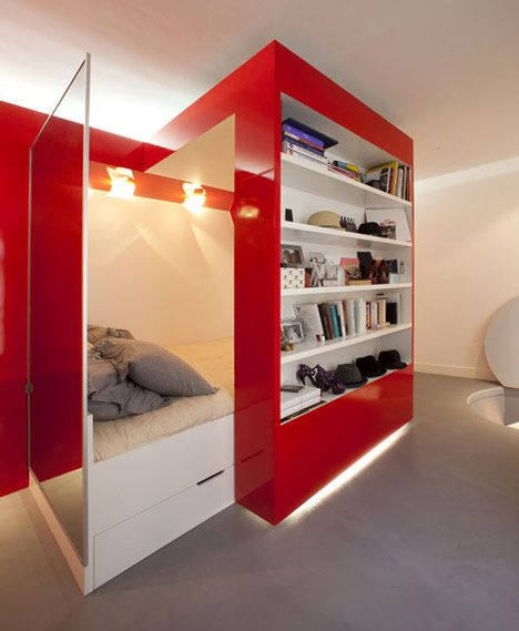 Red Nest: Glossy sliding wall unit combining a desk, bed and wardrobe. Super coo