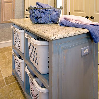 Laundry room island.  A place to fold on top, baskets to put folded laundry in (