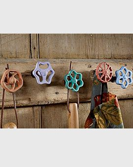 Vintage faucets, brightly painted and used as wall hooks to hang your garden too