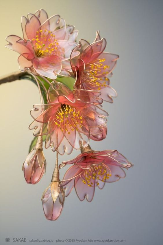 """These beautiful flowers may look like they are made of glass, but they are actually made from wire and liquid synthetic resin. Japanese Kanzashi (hair ornament) artist Sakae is the Maker behind this craft which she calls """"dip flower."""" It involves bending a wire into a desired shape and then dipping it in a liquid plastic.:"""