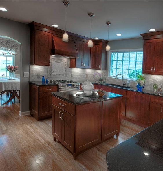 Dark maple cabinets, black granite tops and travertine ... on Backsplash Maple Cabinets With Black Countertops  id=46471