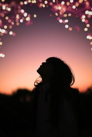 Beautiful picture of a young girl's silhouette against a magical background.: