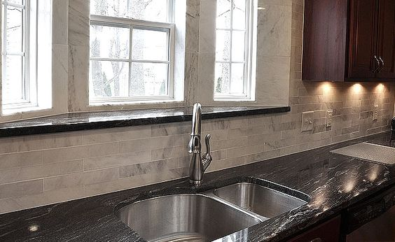 Black granite and dark cabinets lighten up kitchen with ... on Backsplash Ideas For Dark Cabinets And Light Countertops  id=59348