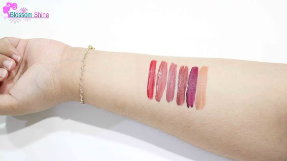 Hand Swatch of BLP Lip Coat (L-R): Candy Apple. Persimmon Pie, Lavender Cream, Beet Root, Red Velvet & Butter Fudge