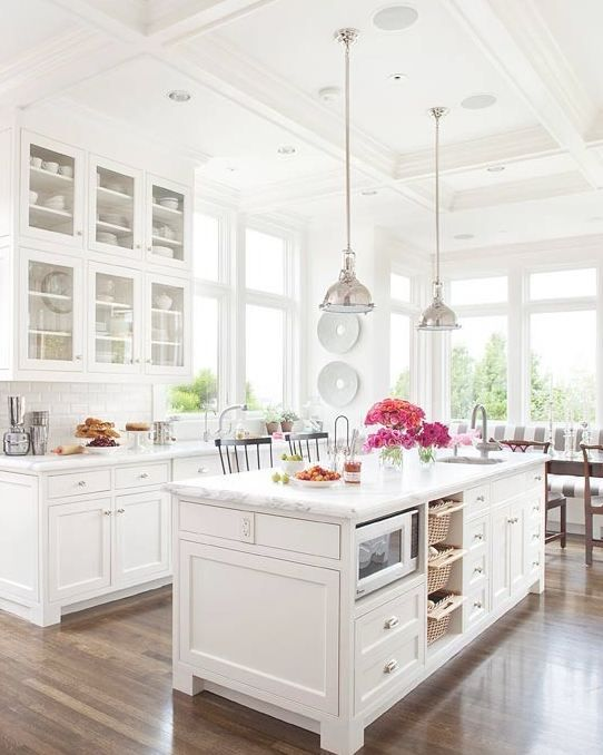 2. With the white tile, white cabinets, marble counters, and tall ceilings, this kitchen looks calm, cool, and collected. But I feel like I need to squint a little. (BHG):