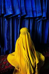 'Woman in canary burqa', 2002. | 24 Striking Pictures Of Afghanistan By Photojournalist Steve McCurry: