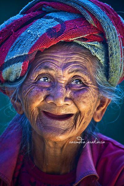 Joyful smile of a Balinese woman...: