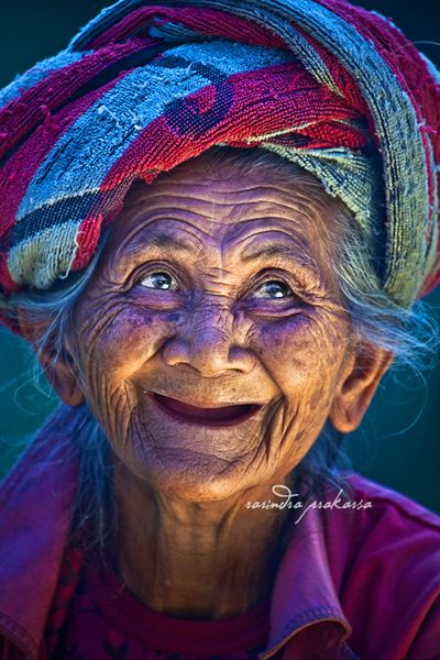 Joyful smile of a Balinese woman...: