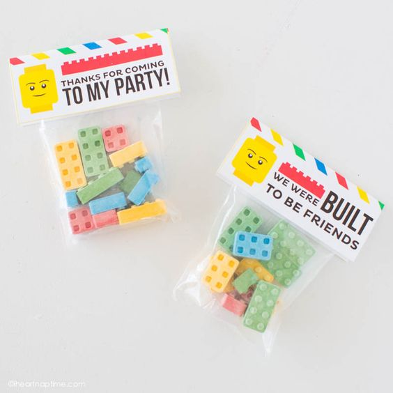 """How to make LEGO crayons and free printable tags that would make a great party favor or Valentine!"" Free Printable Lego Theme Party Favor Treats Toppers 