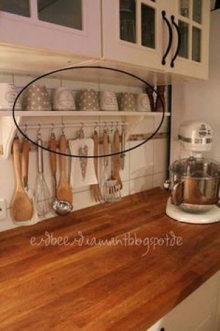 Declutter your kitchen counter with this shelf and little rod which holds utensils.