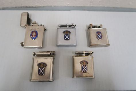 A selection of 1930s cigarette lighters, bearing the school's coat of arms. My lighter is bottom right.