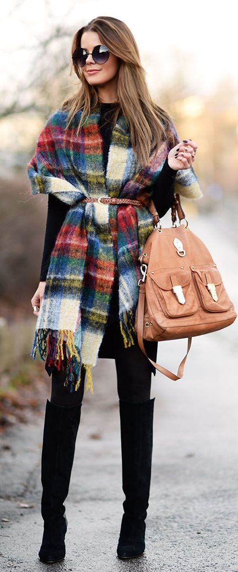 Not sure how to style a blanket scarf? Try wearing it like a poncho and belting it at the waist. It not only adds an extra layer of warmth but it flatters your figure too.: