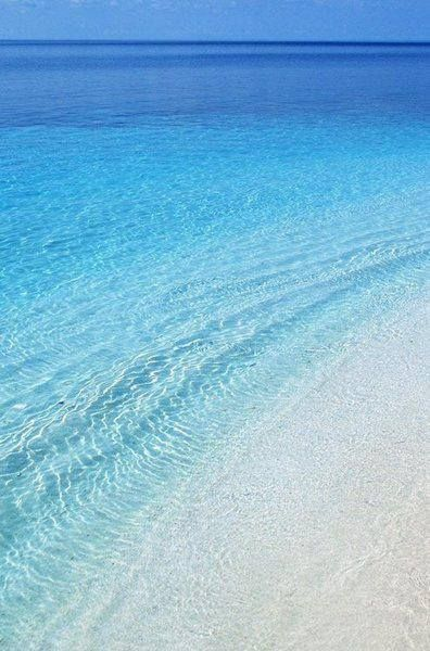 The crystal clear waters of Stelida beach in Naxos: