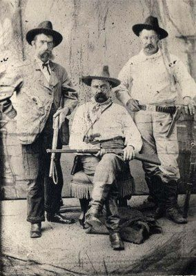 This photograph was made in about 1880, and shows three agents from the Pinkerton Detective Agency. The man in the middle is William Pinkerton, son of the group's founder, Allan Pinkerton. Allan Pinkerton was a personal friend of Abraham Lincoln, and provided protection for the president while he was in office.:
