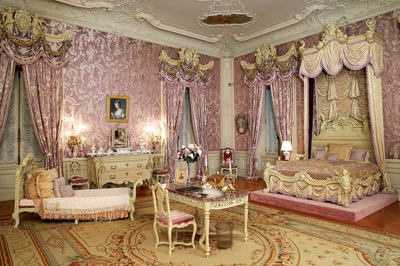Alva Vanderbilt's bedroom with silk lampas wall covering and ornamental cherubs, nymphs and gold garlands Marble House in Newport, Rhode Island: