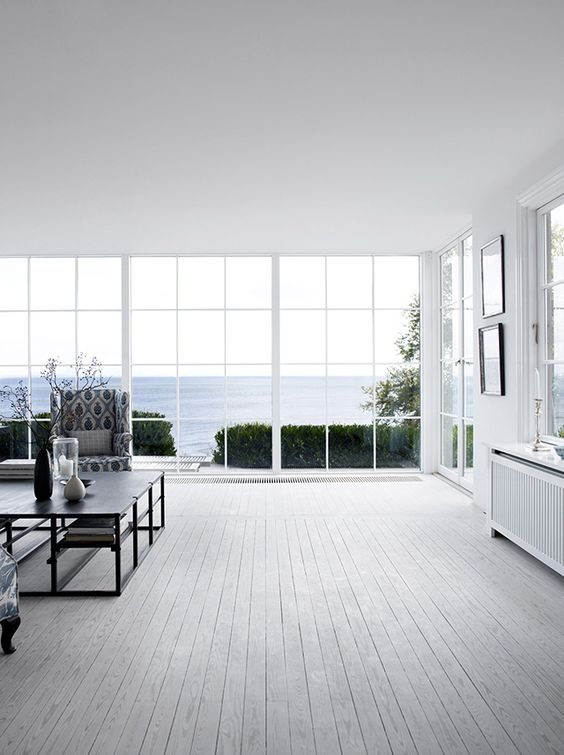 Danish Summer House. The oven really fills the emptiness here. I want those windows and a view.: