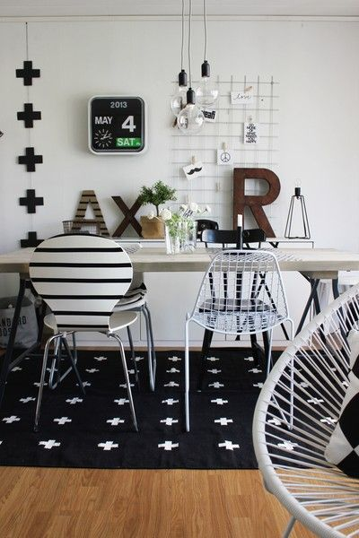 Inspiration & Design. Black and white interior. Plus signs. Graphic rug. Bertoia chairs.: