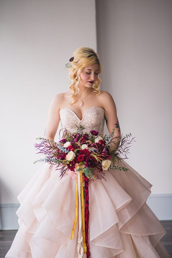 pink wedding dresses photo by MW Photography http://ruffledblog.com/rich-jewel-toned-wedding-ideas: