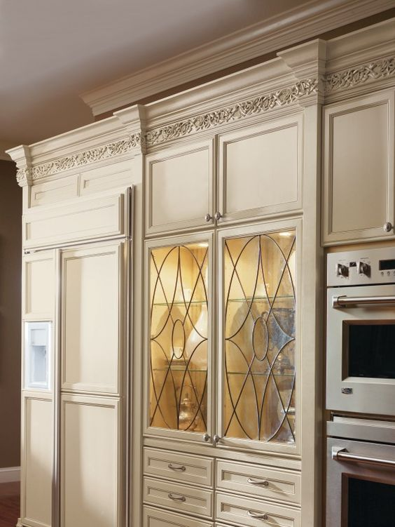 decora s beautiful kensington art glass doors add a bit of character to this cabinet with its on kitchen cabinets glass inserts id=80294