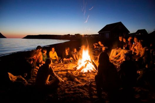 Having a beach bonfire is things to do around San Diego University!