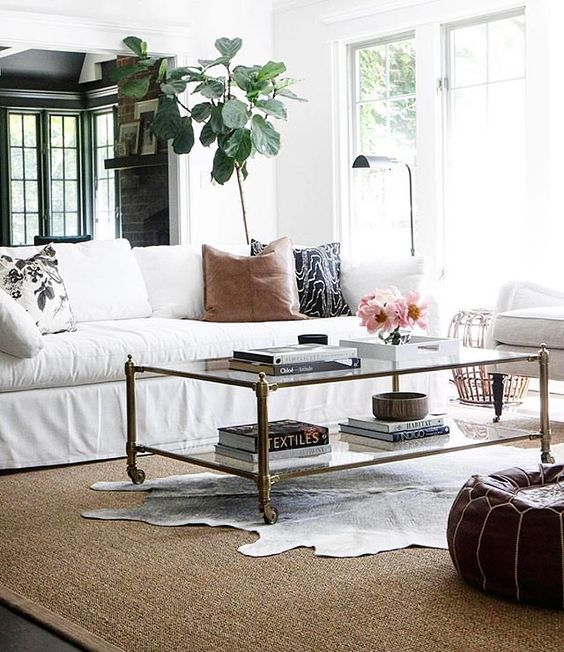 Love this beautiful, transitional space by @parkandoakdesign and I especially love how they layered the cowhide over the seagrass rug...something that is in order around here pretty soon with some upcoming living room changes!! Don't forget to follow the link in profile to check out my latest post all about finding the best faux furs for the season, along with my predictions about fur for fall. Happy Friday✨: