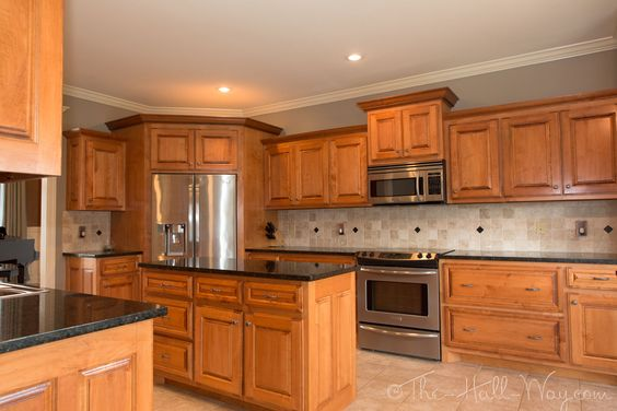 teal taupe oak kitchen | The kitchen had maple cabinets ... on Best Countertop Color For Maple Cabinets  id=51865
