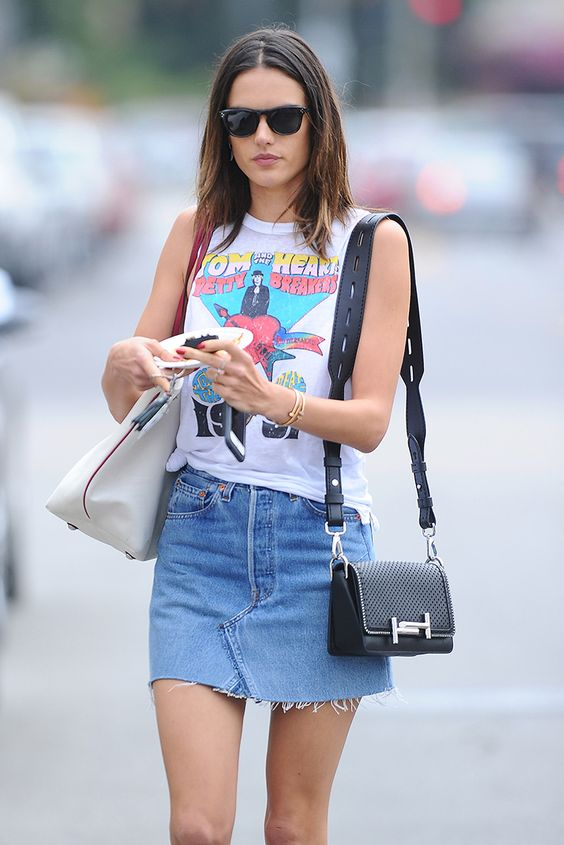 Alessandra Ambrosio is a chic rock chick personified in her band T-shirt and denim skirt.: