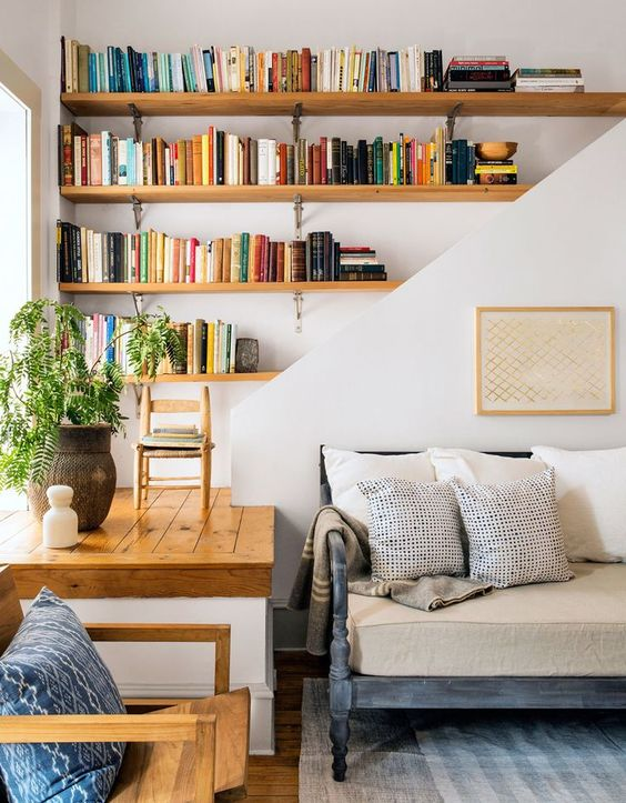 a funky nook is turned into a spot for bookshelves and plants | room via coco kelley: