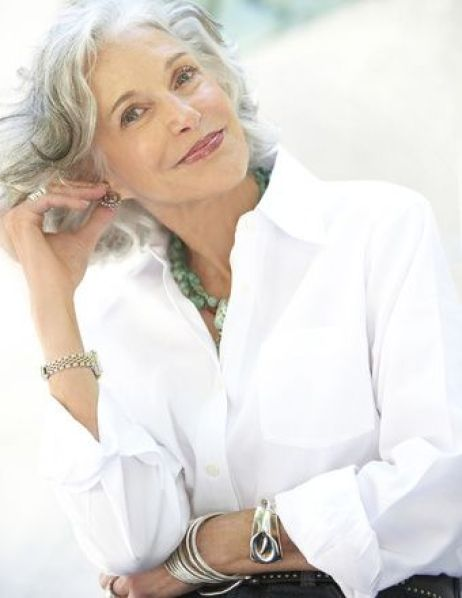 A crisp, white shirt with a collar is so flattering for women over 50. The white bounces light onto the face. The open collar is perfect for adding an interesting necklace. Keep it casual by turning back the cuffs just twice. Put on a big watch and some bracelets for a more youthful look.: